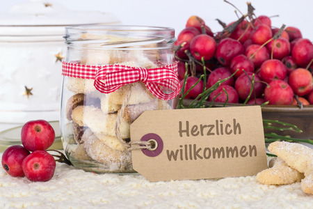 warmly: vanilla crescents and apples with German text warmly welcome