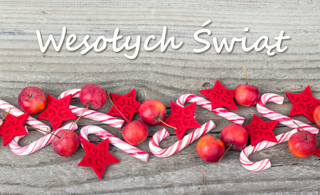 polish christmas card with candy canes apples and text merry christmas stock photo 34904397