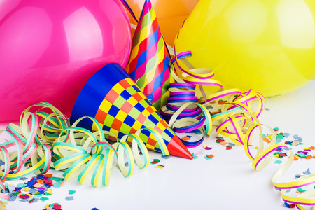 Balloons, streamers, confetti and party hats Stock Photo