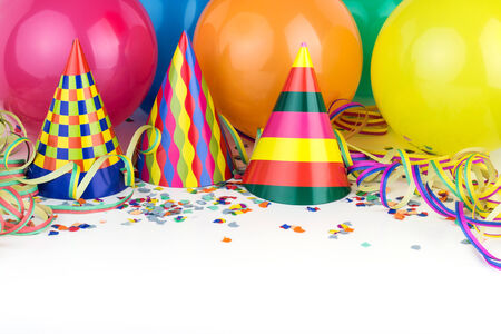 new year eve confetti: Balloons, streamers, confetti and party hats Stock Photo