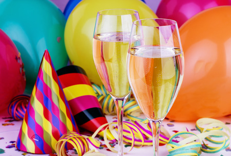 Sparkling wine, streamers, confetti and party hat