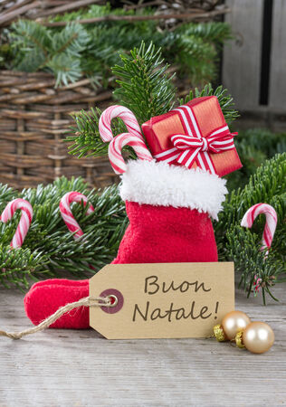 italy christmas card with red sock, gifts, Candy canes and text merry christmas photo