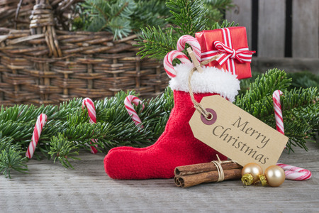 english christmas card with red sock, gifts, Candy canes and text merry christmas photo