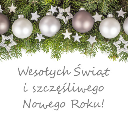polish christmas card with christmas baubles fir branches golden stars and text merry christmas