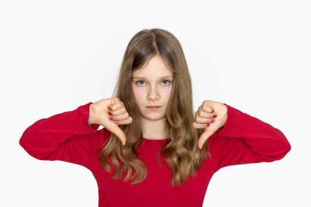 thumbs down: A girl with long hair showing the thumbs down Stock Photo