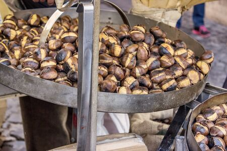 maroni: Chestnuts are roasted in a pan Stock Photo