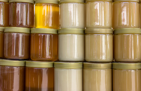 varieties: Glasses with different varieties of honey Stock Photo
