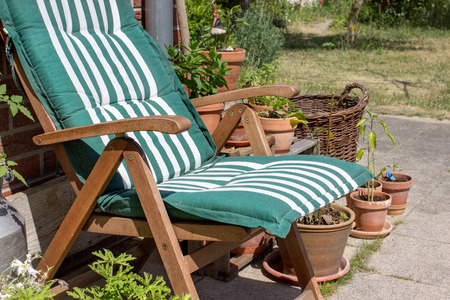 flower pots: Outdoor chair and flower pots on the terrace
