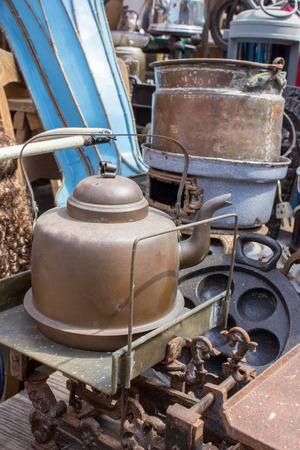 flea market: Flea market stand with scales and Kettle Stock Photo
