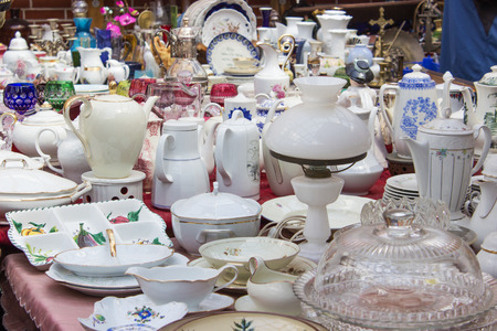antique booth: Table with various old dishes