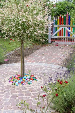 flower garden path: Creative garden door with crayons Stock Photo