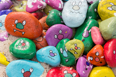 Painted stones with faces Archivio Fotografico