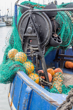 dockside: Detail of a fishing boat at the harbor