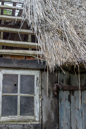 thatched roof: old house with a thatched roof Stock Photo