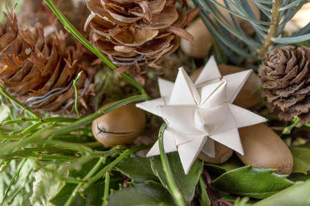 tinker: White paper star with pine branches and cones Stock Photo