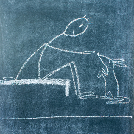 humane: Chalkboard drawing with a man who is feeding an animal