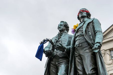 national poet: Monument to Goethe and Schiller before the National Theater in Weimar Stock Photo