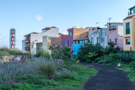 Colorful houses and lighthouse in Puerto de la Cruz Stock Photo