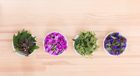 Bowls of different flowers