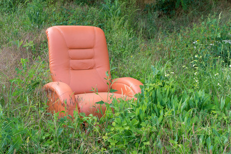 A red chair stands in nature