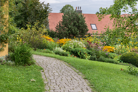 Garden of the Gabriele M�nter House in Murnau Bavaria, Germany Stock Photo - 86187585