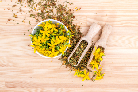 dried and fresh, flowering on wooden background