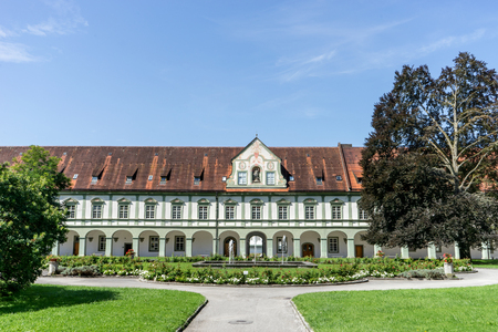 Benedictbeuern monastery in Bavaria, Germany with fountains and green areas
