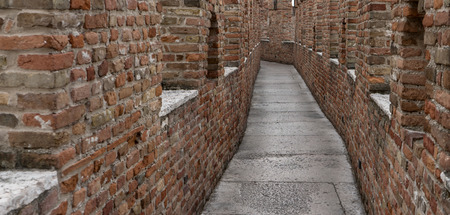 Verona, Veneto  Italy - 10 06 2017: Detail of a medieval castle Castelvecchio with a narrow passageway Editorial