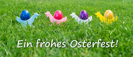Easter card with colorful easter eggs with german text: Happy Easter Stock Photo