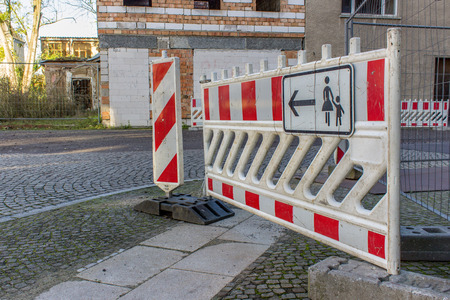 Construction site sign in the barrier at a road Standard-Bild