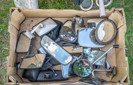 Overhead view of a flea market box with various car mirrors Standard-Bild