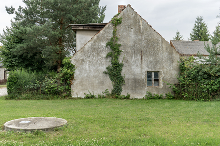 Gable of an old, gray uninhabited house in the countryside