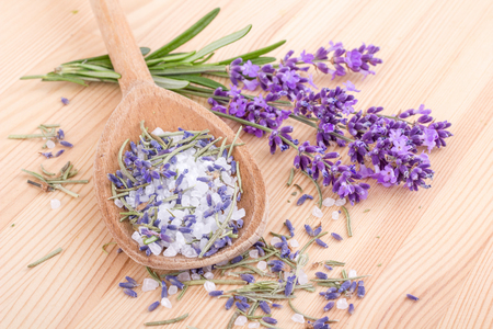 Wooden spoon with rosemary and lavender blossoms