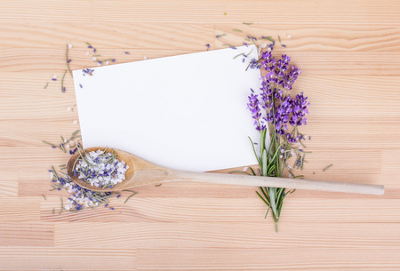 Herb salt with rosemary and white copy space on a wooden background