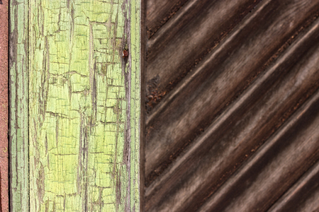 Detail of a wooden door with green and brown surface Standard-Bild