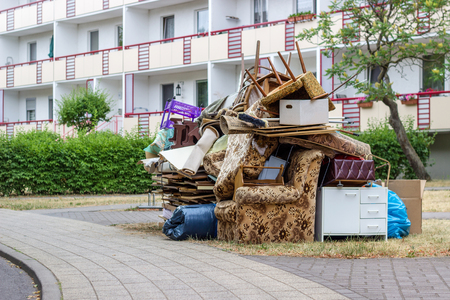 Big pile of old furniture and household goods on the roadside