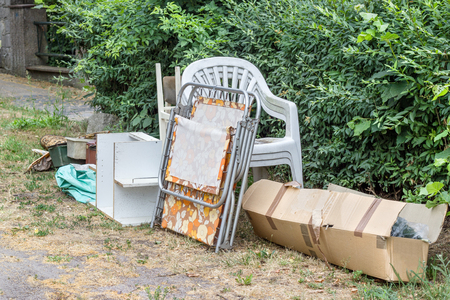 Pile of old furniture and household items on the roadside
