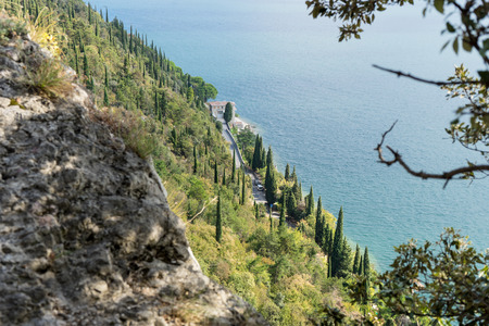 View from the rocks on the shoreline on Lake Garda in Italy