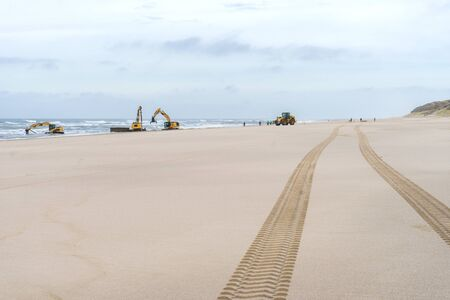 Excavators work on the beach on the island of Sylt Standard-Bild