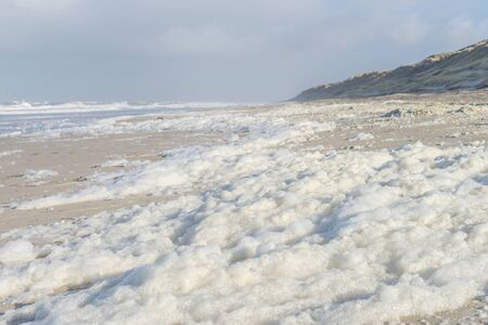 Beautiful seascape of the island of Sylt with sea foam on a sunny day