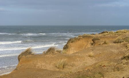 Sand dune of the island of Sylt destroyed by the storm