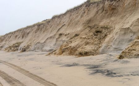 Dune with landslides on the island of Sylt after the storm surge