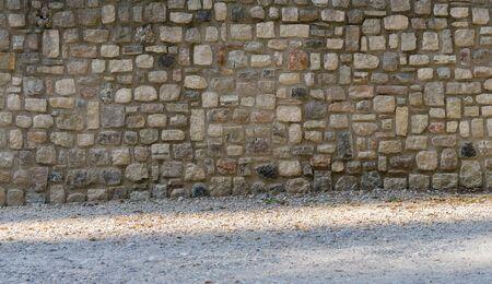 Traditional mediterranean wall made of natural stones Standard-Bild
