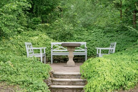 Benches and table in the park at Goethe's garden house in Weimar