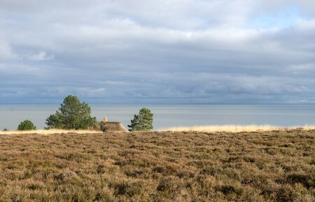 Landscape on the North Sea on the island of Sylt with rain clouds
