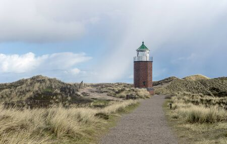 Lighthouse on the Red Reef on the island of Sylt near Kampen Standard-Bild