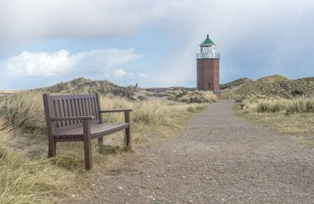 Lighthouse and bench on the Red Reef on the island of Sylt near Kampen