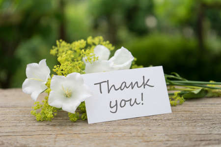 Greeting card with white bell flowers and english text thank you