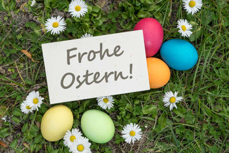 greeting card with easter eggs and german text: Happy Easter Standard-Bild