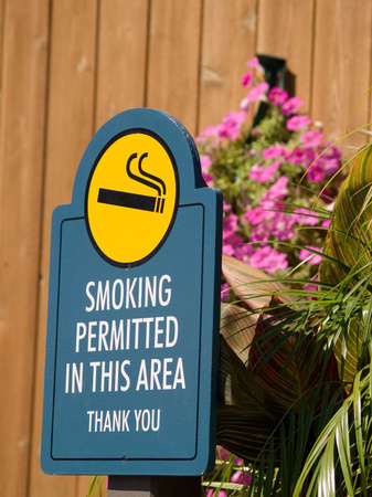 permitted: A sign for a smoking permitted area